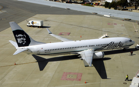 lates: San Francisoc, USA - July 1, 2010: Alaska Airlines passenger jet preparing for flight. Alaska operates a number of Boeing 737-990 jets, the lates series of the popular Boeing 737 line