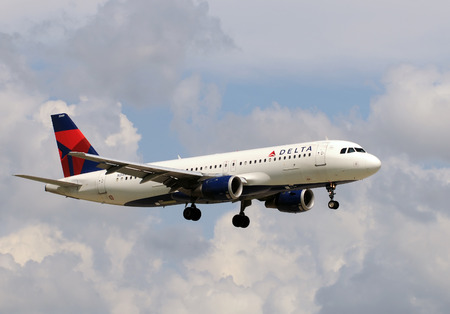 jetliner: Miami, USA - September 17, 2011: Delta Airlines passenger jet airplane landing at Miami International Airport. Delta is one of the largest US passenger carriers Editorial