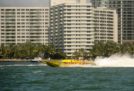 thrill: Miami, USA - September 11, 2011: Tourists enjoy a high speed thrill ride in the wayerways of Miami. Boating is a big tourists attraction for South Florida. Editorial