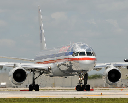 american airlines: Miami, USA - May 22, 2010: American Airlines Boeing 757 passenger jet departing Miami International. Miami is a major hub for American Airlines