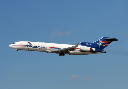 headquartered: Miami, USA - March 4, 2010: Amerijet Boeing 727 cargo airplane taking off from Miami International. Amerijet is headquartered in Miami and is taking aging 727s out of service
