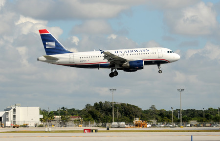 airways: Fort Lauderdale, USA - October 30, 2009: US Airways jet airplane landing at Fort Lauderdale Hollywood International Airport. US Air operates from its hub in Charlotte, NC.