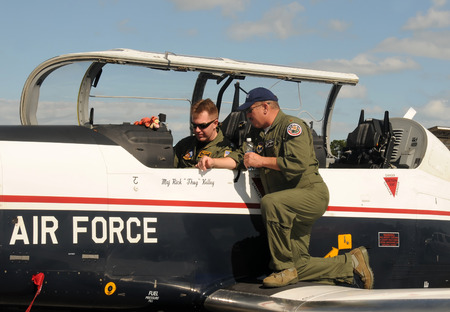 Stuart, USA - November 11, 2011: Instructor and student pilot prepare for flight in the cockpit of a US Air Force training airplane
