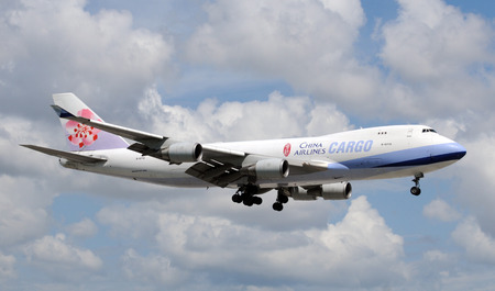 Miami, USA - September 17, 2011: China Airlines Boeing 747 jumbo jet landing at Miami International Airport. China Airlines connects Taiwan with all corners of the world