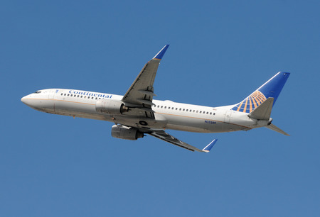 Miami, USA - March 4, 2010: Continental Airlines Boeing 737 passenger jet taking off from Miami International. Continental has now combined operations with United Airlines and replaced the traditional color scheme