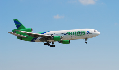 ceased: Miami, USA - June 10, 2007: Arrow Air DC-10 heavy cargo jet landing at Miami International Airport. The airline lost customers in the economic downturn and eventually ceased operation
