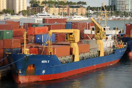 Miami, USA - December 6, 2008: Cargo ship being loaded at the Port of Miami. Miami is one of the busiest container ports in the world.