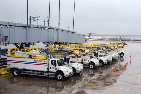 Chicago, USA - March 2, 2012: Crews arrive at OHare airport in Chicago for deicing operation ahead of a snow storm Editorial