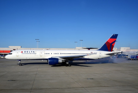 Atlanta, USA - March 4, 2012: Delta Airlines Boeing 757 jet starts engines with smoke at Atlanta International Airport