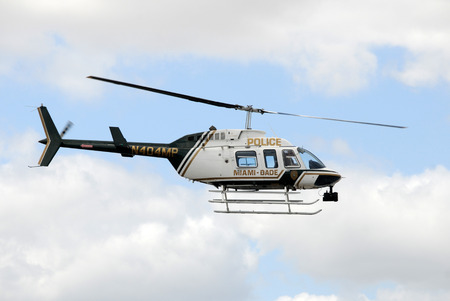 law enforcement: Miami, USA - March 7, 20109: Dade County police helipter departs on patrol over Miami, Florida. the county makes use of technology for law enforcement.