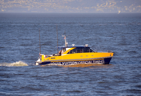 vuitton: San Francisco, USA - October 2, 2012: Louis Vuitton sponsored escort boat arrives for the annual Americas Cut sailing race in San Francisco, California Editorial
