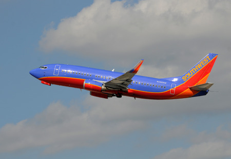 southwest: FORT LAUDERDALE - JANUARY 11: Southwest Airlines Boeing 737 passenger jet departs from Fort Lauderdale, Florida on January 11, 2009. Southwest is the major carrier of Fort Lauderdale.