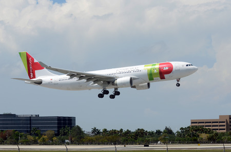 jetliner: MIAMI - APRIL 14: TAP Air Portugal Airbus A330 jetliner arrives in Miami from its home base in Lisbon on April 14, 2013. The airlines started serving Miami in 2013
