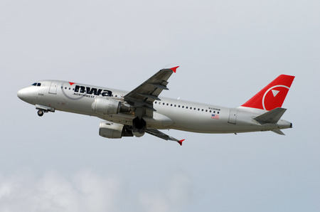 Fort Lauderdale, USA - February 24, 2008: Northwest Airlines Airbus A-320 passenger jet taking off from Fort Lauderdale Holllywood International Airport. Northwest was since acquired by Delta and the fleet was repainted in Delta colors.