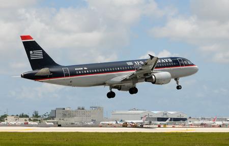 airways: Miami, USA - May 22, 2010: US Airways Airbus A-320 passenger jet landing at Miami international Airport. US Air operates from its main Charlotte, NC hub