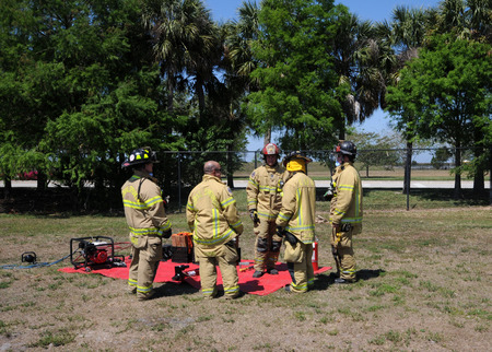 specific: Coral Springs, USA - March 26, 2011: Firemen in Coral Springs, Florida perform training exercise. The fire department addresses the specific needs of the tropical climate in Florida