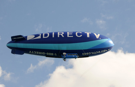 promotional: Miami, USA - January 16, 2011: Colorful airship hovering over Miami with the promotional sponsorship of DitecTV satellite broadcaster