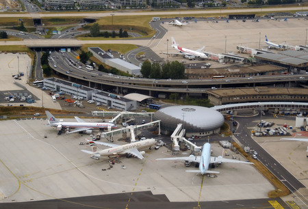 Paris, France - June 6, 2010: Airliners bring passengers to Pariss Charles De Gaulle Airport, one of the busiest hubs in the world