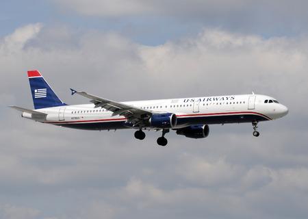 airways: Miami, USA - January 29, 2011: US Airways Boeing 757 passenger jet airplane landing at Miami International airport. US Air uses Charlotte, NC aas its main hub.
