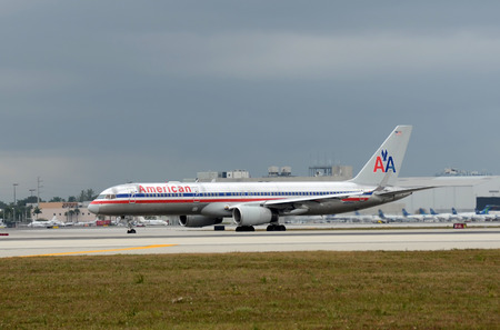 american airlines: Miami, USA - January 29, 2011: American Airlines Boeing 757 passenger jet airplane departs from Miami International airport. American uses Miami as its main hub Editorial