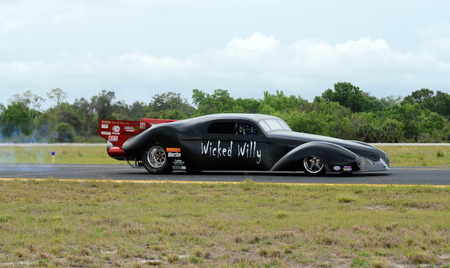 willy: Titusville, USA - March 10, 2012: Jet car testing its engine prior to a race with jetfighter in Titusville, Fllorida. The car bears the name Wicked Willy Editorial
