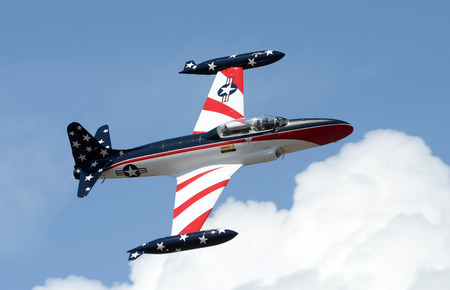 Titusville, USA - March 10, 2012: Early jet era military training airplane arrives for the annual airshow in Titusville, Florida. The T-33 Shooting Star was used from the 50s through the 70s as a jet trainer by the USAF Editorial