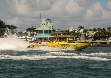 thrill: Miami, USA - September 11, 2011: Tourists enjoy a thrill ride at high speed along the waterways of Miami, Florida, USA