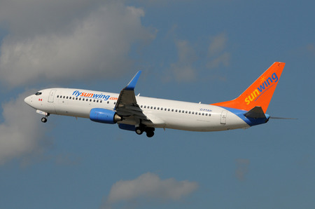 Fort Lauderdale, USA - January 11, 2009: Sunwing passenger jet airplane departing Fort Lauderdales International Airport. Sunwing is a major carrier of Canadian tourists to Florida and other resrt destinations Editorial