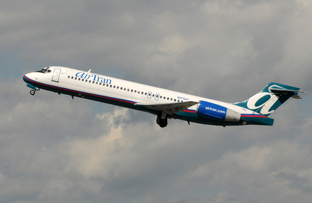 Fort Lauderdale, USA - January 11, 2009: Air Tran passenger jet airplane departing Fort Lauderdales International Airport. Air Tran is a growing US low cost carrier, recently acquired by Southwest Airlines Editorial