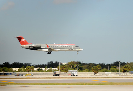 Fort Lauderdale, USA - January 11, 2009: Northwest Airlines regional jet landing at Fort Lauderdales International airport. Northwest was eventually acquired by Delta Airlines.