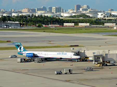 Fort Lauderdale, Aurgust 9, 2012: Air Tran passenger jet airplane loads passengers in Fort Lauderdale, Florida, Air Tran has recently been acquired by Southwest Airlines