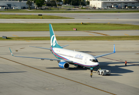 Fort Lauderdale, USA - August 9, 2012: Air Tran Boeing 737  passenger jet airplane arrives in Fort Lauderdale, Florida. Air Tran has recently ben acquired by Southwest Airlines