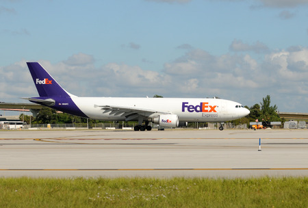 tn: Fort Lauderdale, USA - October 30, 2009: Fedex cargo jet airplane departs from Fort Lauderdale, Florida to the companys main hun in Memphis, TN