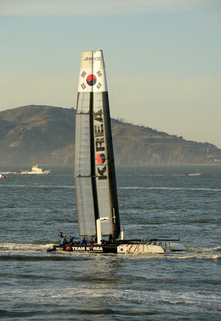 San Francisco, USA - October 2, 2012: Americas Cup Team Korea boat sails in the San Francisco Bay prior to racing day. This is a newcomer team for 2012.