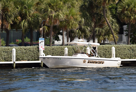 waterways: FORT LAUDERDALE - OCTOBER 11: Broward County Sheriff patrols the waterways of Fort Lauderdale, Florida on October 11, 2014. Police boat are common law enforcement tool in South Florida Editorial