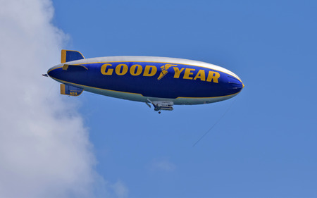 blimp: FORT LAUDERDALE - OCTOBER 11: Good Year blimp flies up and down the Florida coastline near Fort Lauderdale on October 11, 2014