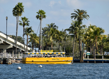 waterways: FORT LAUDERDALE - NOVEMBER 15: Tourists enjoy a trip along Fort Lauderdales waterways aboard a water taxi on November 15, 2014. Floridas coastline is known for its numerous waterways.