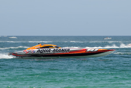 FORT LAUDERDALE - JUNE 7: Aqua Mania speed boat takes part in the 5th Annual Ft Lauderdale Super Boat Grand Prix sponsored by Panasonic. The event was held on June 7, 2009 in Fort Lauderdale, Florida
