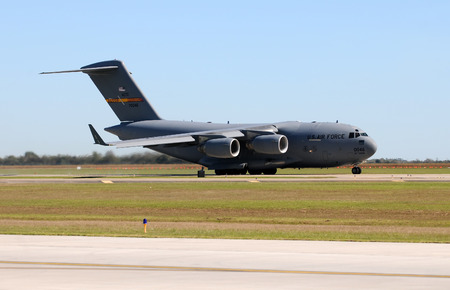 usaf: Houston, USA - November 1, 2009: US AIr Force C-17 Globemaster jet arrives in Houston, Texas for refueling. It is the most popular heavy lift jet of the USAF