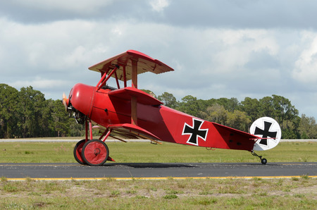 world war: Retro red airplane from World War I side view