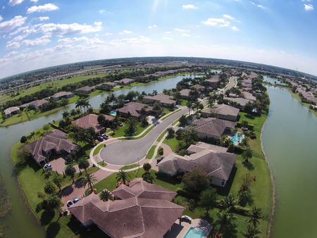 Waterfront homes in Florida seen from above flyover view Editorial