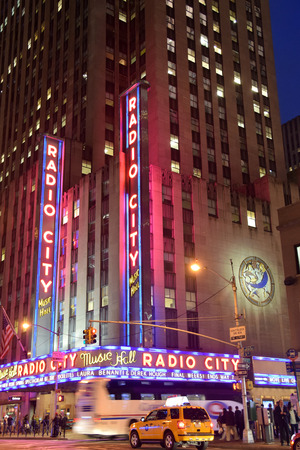 showbusiness: NEW YORK - APRIL 27: Night traffic sppeds past landmark Radio City Music Hall in New York City on April 27, 2015. The venue is legendary in entertainment industry Editorial