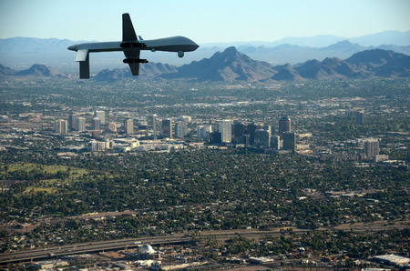 city surveillance: Surveillance drone flying over US city
