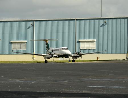 turboprop: Modern turboprop airplane parked in front og handgar Editorial