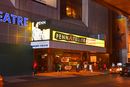 NEW YORK - JULY 12: Penn and Teller billboards announce summer shows on Broadway seen on July 12, 2015 in New York City Editorial
