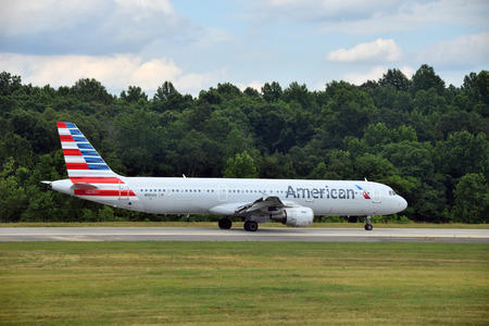 american airlines: CHARLOTTE - JUNE12: American Airlines Airbus A321 jet departs from Charlotte, NC on June 12, 2015. American has added a number of new 321 jets for coast to coast travel routes