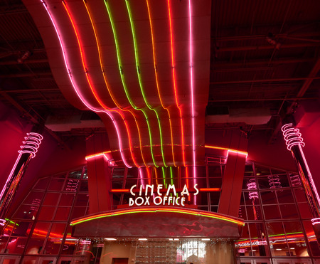 Bright neon lights of retro style movie theater