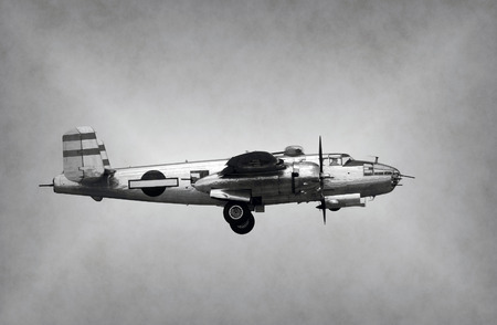world war two: World War II era bomber in flight side view