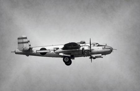 world war ii: World War II era bomber in flight side view