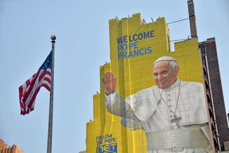 dedicated: New York, USA - September 3, 2015: Giant outdoor mural greets visitors and locals in New York City dedicated to the Popes visit in 2015